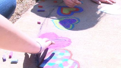 Each student is lending a helping hand to paint an outdoor mural dedicated to Jack.