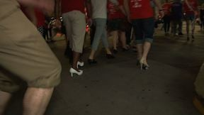 Men put on high heels to walk to raise awareness for sexual assault.