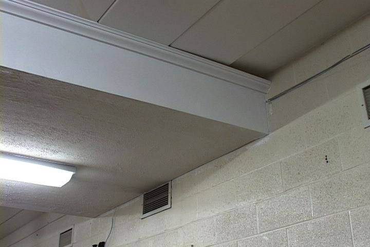 Architects found problems with the roof in two academic wings of Ninety Six High School.  Here you can see that the concrete slabs of the ceiling are not even.