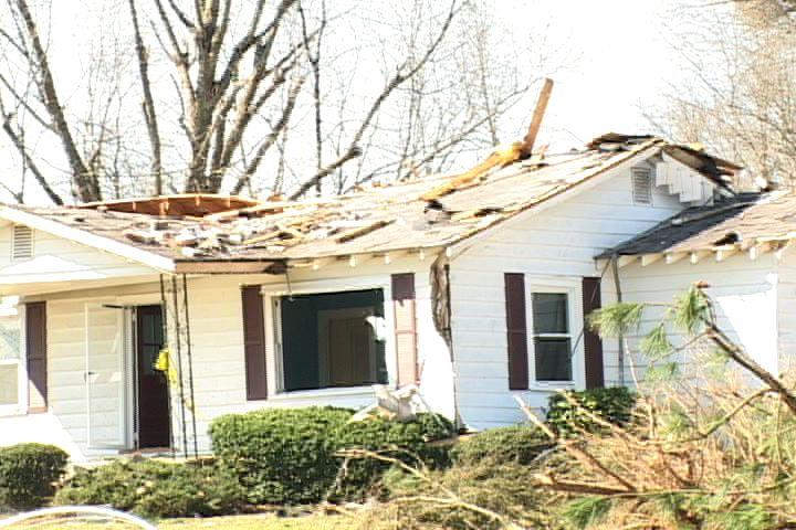 Home damaged by a tornado in Prosperity