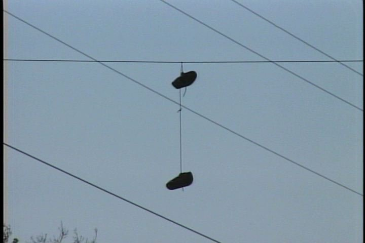Shoes hanging from power lines are a symbol of gang activity.