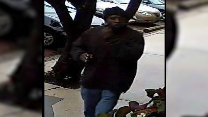 Police are looking for this man, pictured in a security camera image captured outside the store.