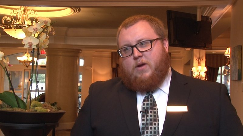 Grayson Beard, concierge at the Hilton, has worked overtime to comply with the surge of reservations.
