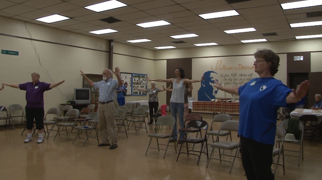 Members of The Friendship at the kick off event participating in the Tai Chi activity.