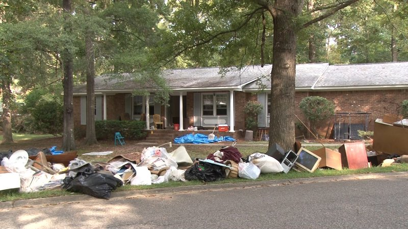 Hulbert's belongings are now strewn out in his front yard.