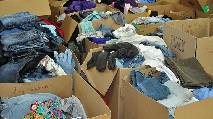 Clothes stack up after volunteers seperated tons of clothes donated to a Columbia water distribution site. Volunteers divided the clothes, that came in trash bags, by gender and size.