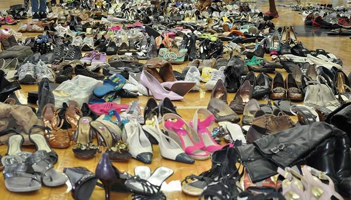 Dozens of shoes line the floor of Lower Richland High, one of eight government-ran water distribution sites in Columbia. The site received tons of donations from the community, to give to anyone in need after the South Carolina flooding.