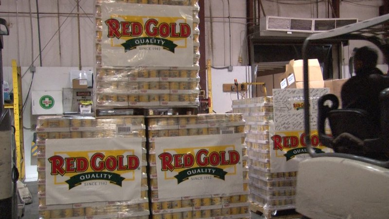 Red Gold Tomatoes delivered a donation of 43,000 canned goods to Harvest Hope Food Bank on Monday.