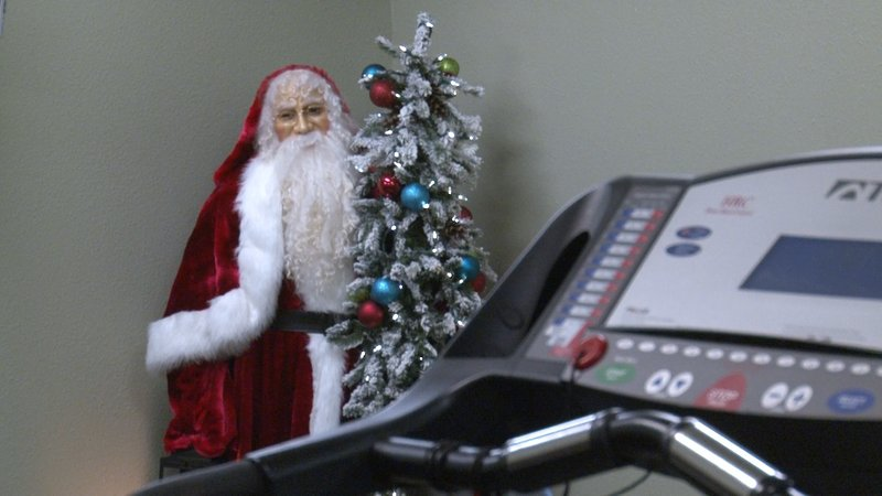 Santa watches over the Holly Health Club or gym from the corner.