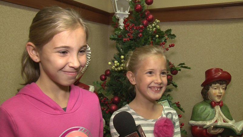 First-time guests Kylie and Kenzie Pendergraft show how excited they were to hear Santa sing to them.