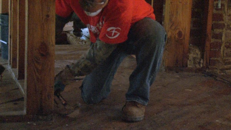 Volunteers removed nails and wood to help families begin the rebuilding process.