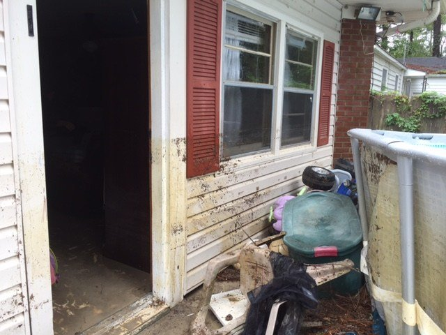 Four feet of water filled Angelo's home and washed away family belongings. (photo credit:Giulia Dempsey)