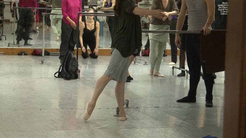 Dancers warm up before rehearsal.