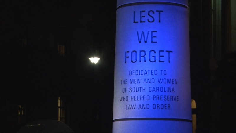 The memorial was lit blue to honor those fallen in the line of duty.
