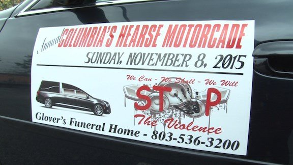 """This """"stop the violence"""" sign was placed on the first hearse that led the motorcade through neighborhoods."""