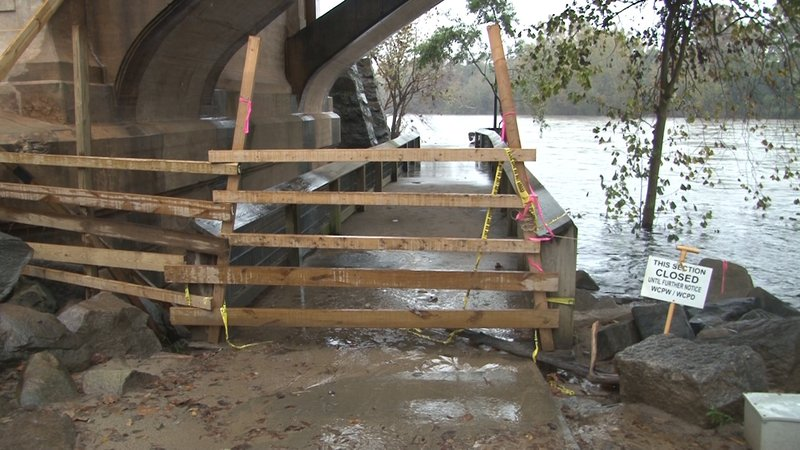 Many sections of the Cayce riverwalk, like this one under the Gervais street bridge, are closed off and partially submerged.
