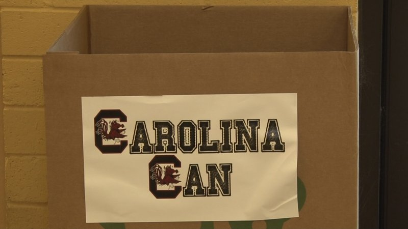 Students and fans can donate canned food at several locations in Columbia.