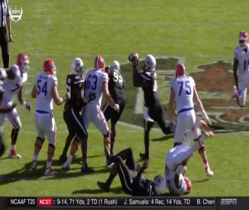 Defensive end, Marquavius Lewis, tackles the quarterback and Dixon intercepts the ball.