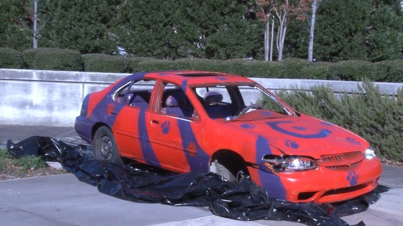 """Students lined up outside the Swearingen engineering building to take a sledgehammer to the """"Clemson Car."""""""