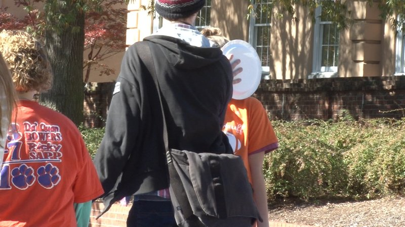 """Epsilon Sigma Alpha allowed students to pie """"Clemson fans"""" in the face to raise money for Easter Seals."""