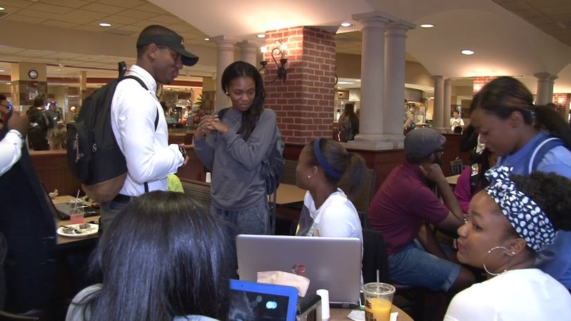 Carlos Washington spends time with friends between classes at USC's Russell House.