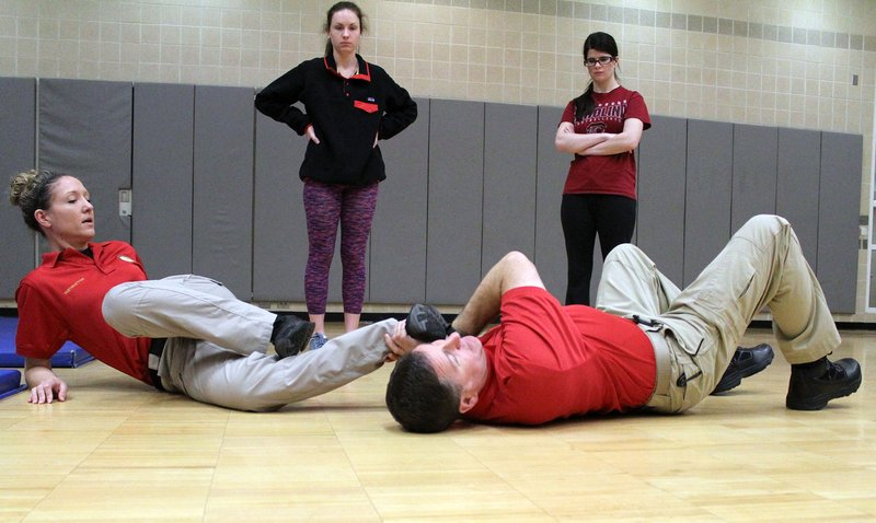 "Sgt. Jessica Velders, left, and Patrol Officer Inmon teach self-defense techniques from USC professor Ed Carney's ""Surviving Assault and Standing Strong"" organization."