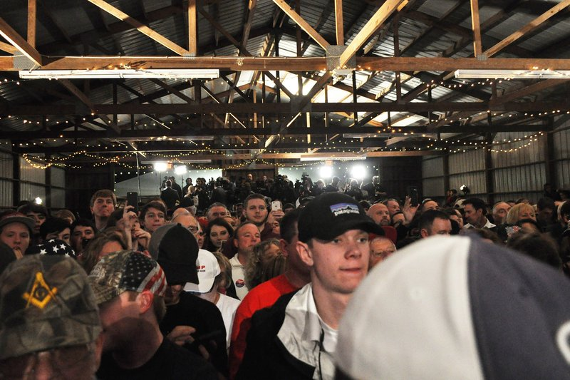 "By Colin Demarest: Camera lights drowned out the hanging Christmas lights as a bank of reporters and people eagerly awaited Trump's arrival. The crowd, stuffed into a Gilbert, South Carolina barn, chanted ""Trump!"" louder as the clock apporached 7 p.m."