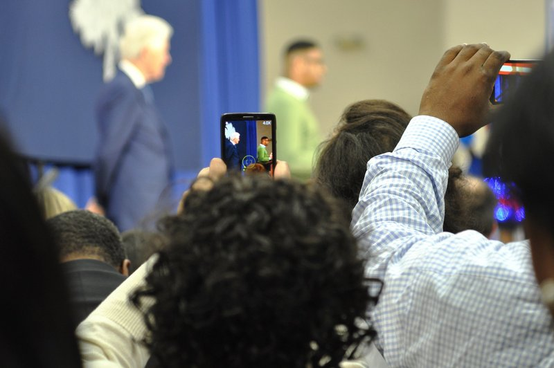 """Eager to catch the former president on camera, many in the crowd whipped out their phones as he stepped on stage. Supporters boomed as former President Clinton said he was """"very grateful to the people of South Carolina."""""""
