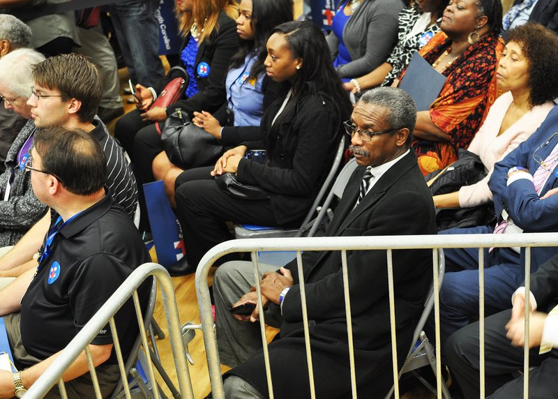 """Lonnie Randolph, Jr., center, president of the South Carolina NAACP, complimented President Clinton's speech, saying he's a """"good speaker and a great motivator."""" Randolph was among the 815 people in attendance Wednesday night at the Clinton rally."""