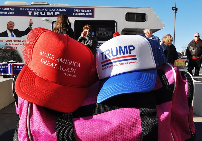 Vendors outside the Florence Civic Center sold a wide range of merchandise including hats, pins, scarves, blankets, and even copies of Time magazine that mentioned Trump on the cover.