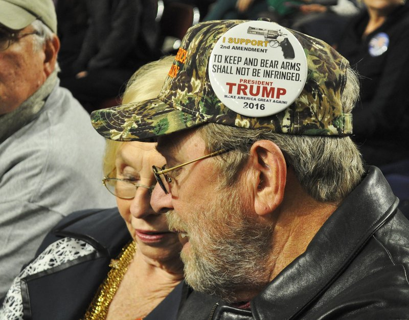 Many supporters demonstrated their specific support for Trump with pins they bought outside the event. Pins, like this one, parrot the candidate's stances. (Photo by Colin Demarest)