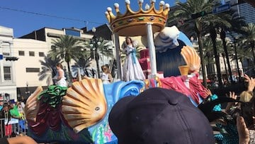 Mardi Gras parade floats fill New Orleans streets.