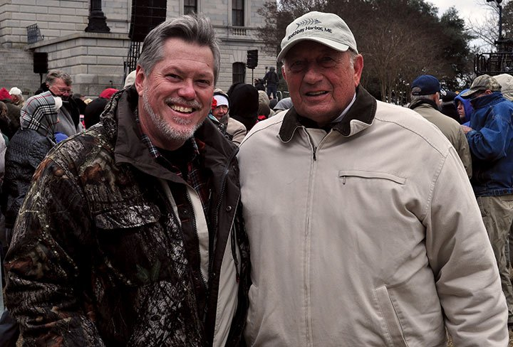 Joey Werts, left, came to the S.C. State House to hear the Rev. Franklin Graham. Werts is an undecided voter but said he will support a candidate who believes in the Bible.