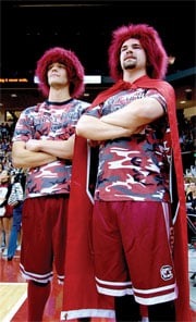 """Dillon Smith, left, and Sam Hill lead the student's """"Garnet Army"""" in cheers at home games. Smith and Hill were named the """"generals"""" of the army by game emcee Curtis Wilson."""