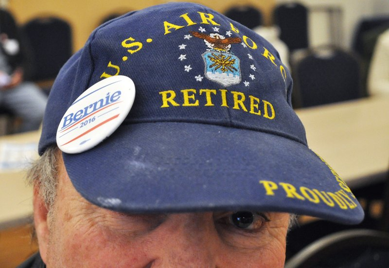 """Bob Meyers was just one of many men who attended the """"Women for Bernie"""" get together. Meyers, now retired from the U.S. Air Force, strongly dislikes presidential candidate Donald Trump despite Trump's strong standing with veterans."""