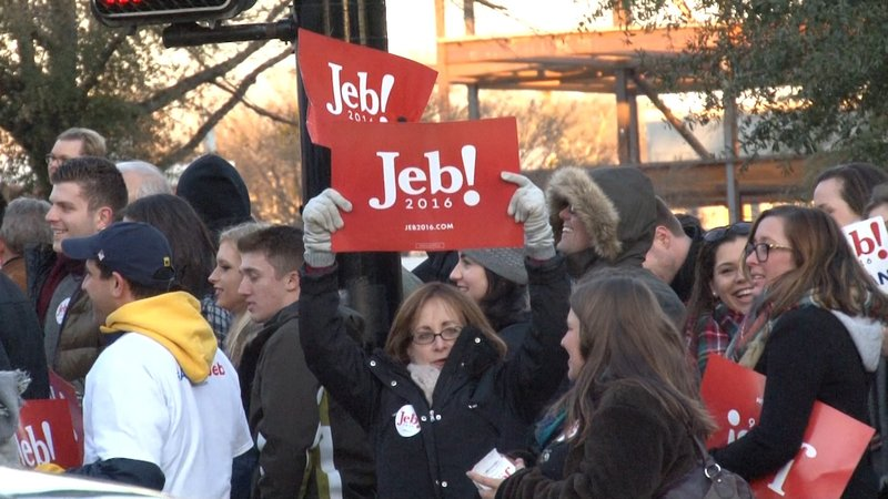 Jeb Bush supporters hold signs outside the Peace Center before Saturday night's debate.