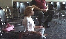Faculty members meditate in Marguerite O'briens meditation class