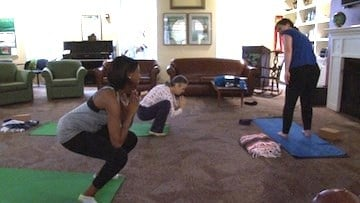 Speats and Breedlove participate in an early morning yoga class