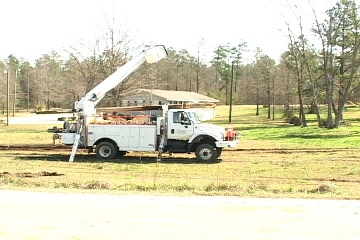 Crews work to repair the power lines in Prosperity that were damaged by the tornados.