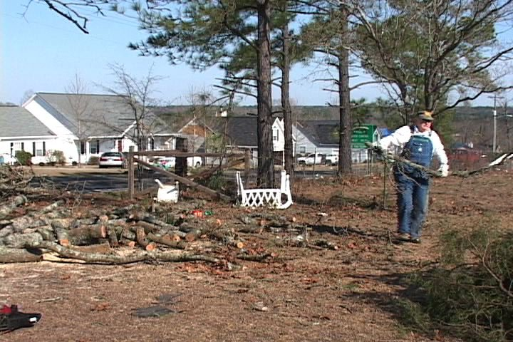Volunteers from all across the state come to Elgin to help pick up debris to be hauled away.