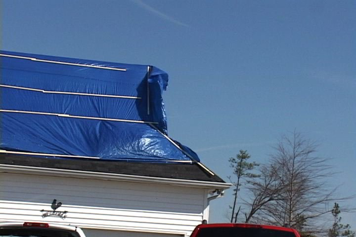 Tarps cover holes in roofs to protect homes in Newberry County from getting any more damage.