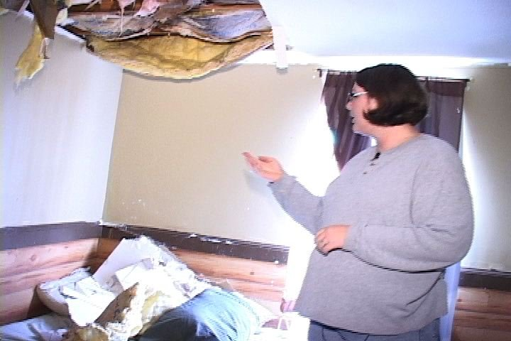 Lori Cooper at her damaged home